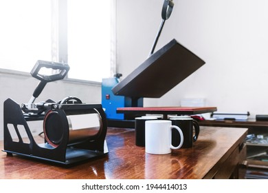 machine for sublimation designs for mugs and t-shirts. advertising and graphic design concept.