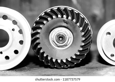 Machinery concept. Set of various camshaft gears and ball bearings old and new