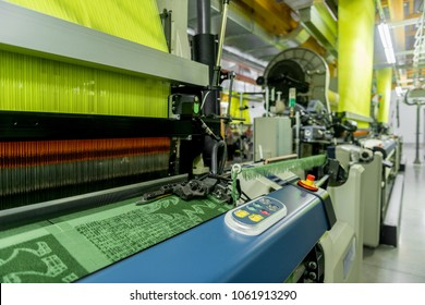 Machinery and equipment in the weaving shop, detailed review. interior of industrial textile factory. loom