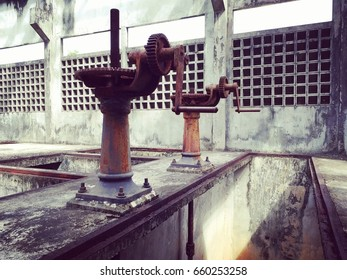 machinery opening the floodgate in the sewage treatment plant.