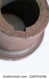 Machinery part failed by fatigue mechanism. The crack originated at the corner of keyway, where it introduced a high stress concentration when applying torque, then propagated through thickness.