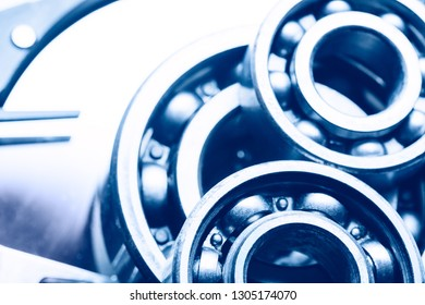 Machinery and technology background. Group of various ball bearings on hard disk drive.