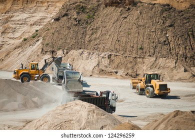 Machines working at gravel pit