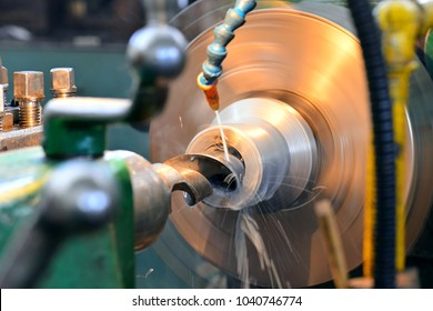 Machining on a lathe, internal boring of a part with a tool.