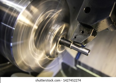 Machining parts on a lathe. A vice clamp the workpiece, which sharpens the cutter.