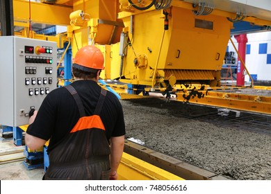 Machinist in a factory. Manufacture of bricks