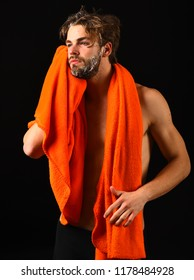 Macho attractive nude guy black background. Man bearded tousled hair covered with foam or soap suds. Wash off foam carefully. Man with orange towel on neck ready to take shower. Body care concept.