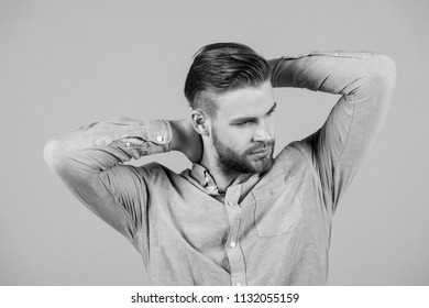 Macho in blue fashionable shirt, fashion. Man with bearded face and blond hair, haircut. Mens fashion style and trend. Grooming and hair care in beauty salon, barbershop.