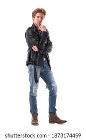 Macho confident redhead stylish rocker male fashion model posing at camera with hand on chin. Full body length isolated on white background.
