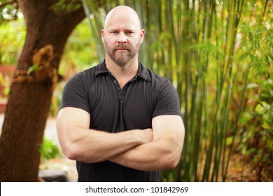 Intimidating guy with arms crossed