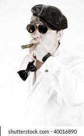 Macho man with cigar and sunglasses. High key.