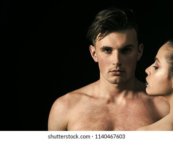 Macho on pensive face with muscular figure, enjoy female attention. Man with muscular torso, macho and female face, dark background. Pheromones, desire and attraction concept.