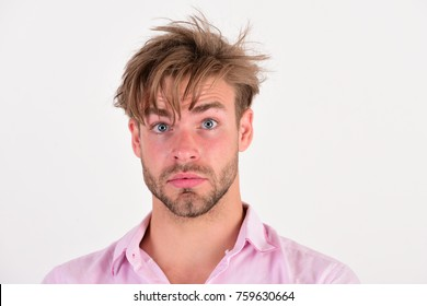 Macho with surprise on his face. Man with blue eyes wide open isolated on white background. Masculinity and style concept. Guy with bristle in pink shirt and messy hair.