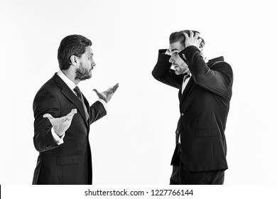 Machos in classic suits have business argument. Unshaven men argue, isolated on white background. Business controversy concept. Businessman with surprased face holds head.