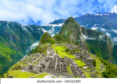 Machu Picchu, Cusco region, Peru:  Overview of the ancient sacred city, terraces and Wayna Picchu peak, in the background.