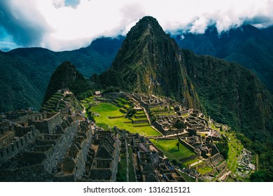 Machu Picchu, the lost city of the Incas on a cloudy day. Machu Picchu is one of the new Seven Wonder of the Wonders near Cusco, Peru.
