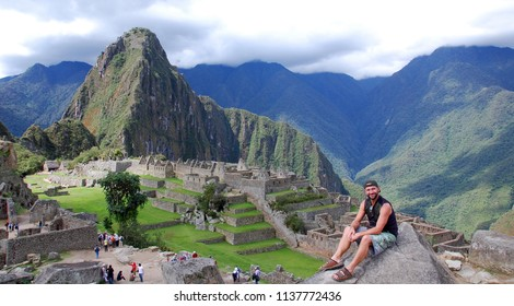 MACHU PICCHU NOVEMBER 24 2010: Tourist in from the Machu Picchu site is a 15th-century Inca site located 2,430 metres (7,970 ft) above sea level