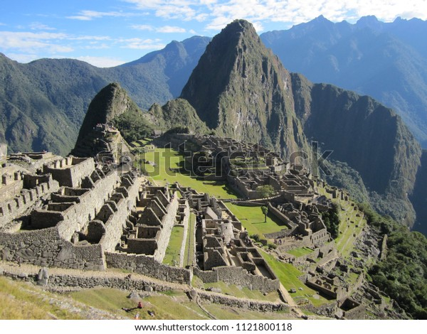 Machu Picchu on a beautiful sunny day with blue skies.