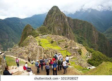 Machu Picchu, Peru - 11/5/2015:  A wide angle view of Macchu Picchu with a group of tourists in the foreground, Peru.