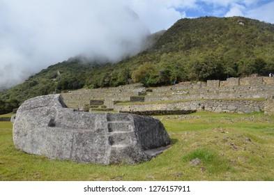 MACHU PICCHU / PERU, August 16, 2018: Visitors overlook the ceremonial rock at Machu Picchu