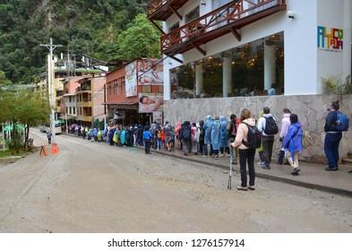 MACHU PICCHU / PERU, August 16, 2018: Tourists line up to get on the buses to go to Machu Picchu