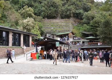MACHU PICCHU / PERU, August 16, 2018: Tourists at the entrance to Machu Picchu