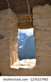 MACHU PICCHU / PERU, August 16, 2018: Window in Machu Picchu overlooks a mountain.
