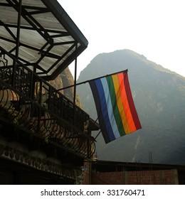 MACHU PICCHU, PERU - JULY 13: Flag of Cusco, in the Machu Picchu town, on July 13, 2015 in Machu Picchu, Peru.