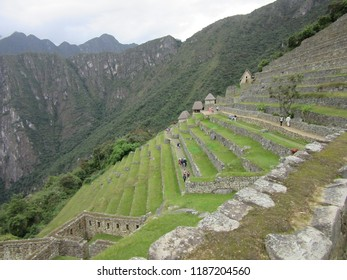 Machu Picchu, Peru - June, 10, 2017: An angled daytime shot of the magnificent terraces along the mountaintop of Machu Picchu in Peru.