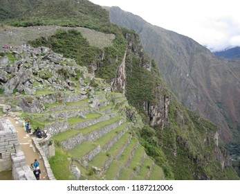 Machu Picchu, Peru - June 10, 2017: A steep, angled daytime view of the mountaintop and terraces at Machu Picchu.