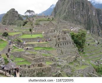 Machu Picchu, Peru - June 10, 2017: An ancient Incan maze of pathways and steps across Machu Picchu.