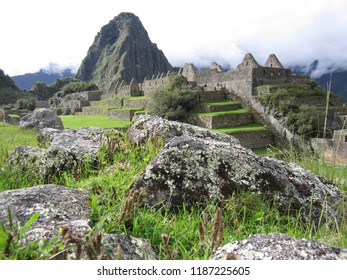 Machu Picchu, Peru - June 10, 2017: The clouds and mountains stand guard over the deserted stone structures at Machu Picchu.