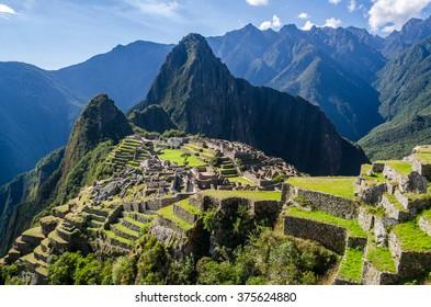 MACHU PICCHU, PERU - JUNE 29, 2015: view on the Machu Picchu on a sunny day, it is the most familiar icon of Inca civilization
