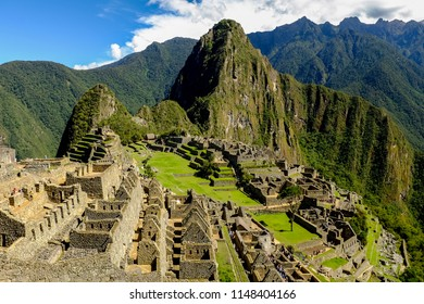 MACHU PICCHU, PERU - OCTOBER 19, 2017: Tourists enjoy the beautiful landscape at Machu Picchu, One of the New Seven Wonders of the World and UNESCO World Heritage Site in Peru.