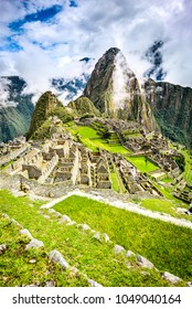 Machu Picchu in Peru - Ruins of Inca Empire city and Huaynapicchu Mountain in Sacred Valley, Cusco, South America.