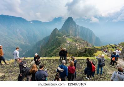 Machu Picchu, Peru - Sep 14, 2018: Tourist visiting and taking photos at Machu Picchu in Peru