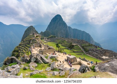 Machu Picchu, Peru - Sep 14, 2018: Tourist visiting Machu Picchu in Peru. It is an Inca citadel and one of the most popular tourist destination in Peru.