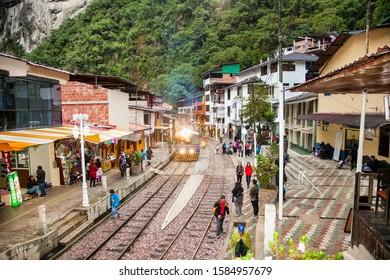 Machu Picchu Pueblo,  Peru - Jan 7, 2019: The Train arriving at Aguas Calientes town, the closest access point to the archaeological site of Machu Picchu, Cusco region, Peru. South America.