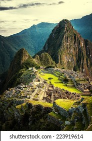 Machu Picchu at sunset when the sunlight makes everything golden-warm.