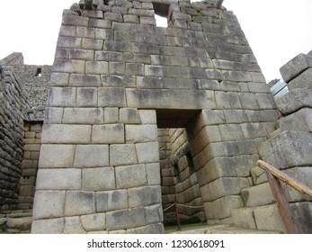 Machu Picchu/Peru - May 21, 2017: Large carved stone blocks make up the Gate of the Sun in Machu Picchu.