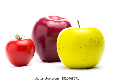 Macintosh Apple , Granny Smith Apple and red tomato. Fruit Composition health concept
