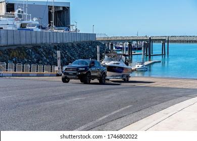 Mackay, Queensland, Australia - June 2020: Fisherman launching his boat at recreational public boat ramp at the marina