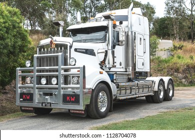 Mackay, Queensland/Australia - 1 July 2018: White Kenworth Prime mover with sleeper and without a trailer parked on a road surrounded by trees and bushes