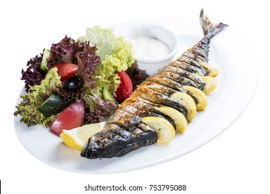 Mackerel baked with lemon. On a white plate