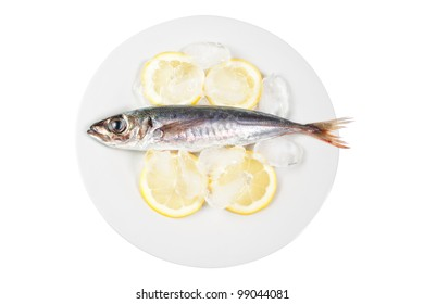 Mackerel in the bowl with the lemon. On a white background.