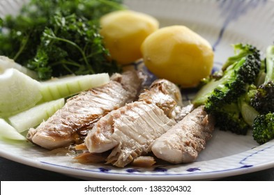 Mackerel fish dish with potatoes, broccoli, onions and parsley. Fatty, oily fish is an excellent and healthy source of DHA and EPA, which are two key types of omega-3 acid.