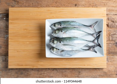 Mackerel Fish On Bamboo Wooden Chopping Board
