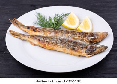 Mackerel fried on grill, served with lemon and dill