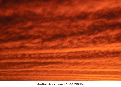 Mackerel sky at sunset with vibrant orange and yellow clouds undulating across the view