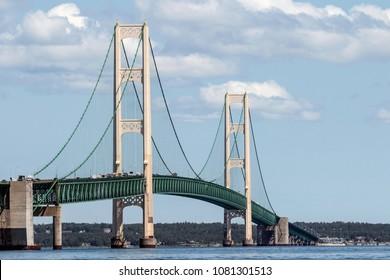 The Mackinac Bridge in the sunlight separating the Upper and lower peninsulas of Michigan.